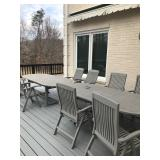 Teak patio furniture set with 2 tables and 11 chairs. $1,500