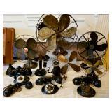 Several antique telephones and fans