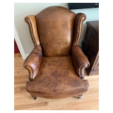 BROWN LEATHER STUDDED READING CHAIR $250