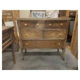 Old solid wood 4 drawer chest with wheels