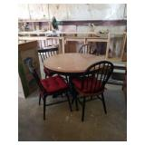 Table with 4 chairs with cushions